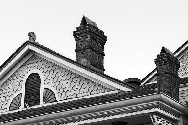 Black and white photograph of a beautiful old Victorian house in the New Orleans French Quarter.