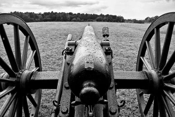 Black and white photograph of a black cannon, covered in rain drops, as it looks out over the landscape at the Chickamauga Battlefield, in Georgia, not far from Chattanooga, Tennessee.