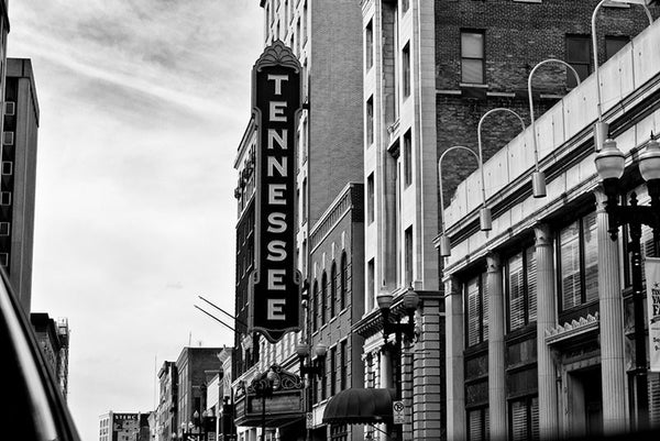 "Black and white photograph of the Tennessee Theater sign in Knoxville. The Tennessee Theater is a historic 1920s movie house, built on a site that has been occupied since the 1790s. The theater opened in 1928 with a massive organ known as ""The Mighty Wurlitzer,"" which has since been refurbished and returned to its home in the theater."