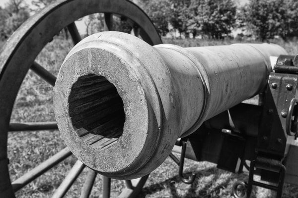 Black and white photograph of a civil war cannon on the site of the bloody battle of Murfreesboro, Tennessee on Stones River civil war battlefield.