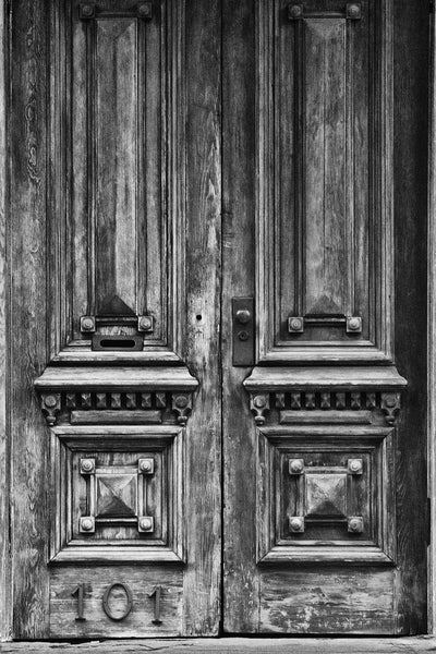 Black and white photograph of two beautifully weathered and aged wooden doors in Savannah's historic district at house no. 101.