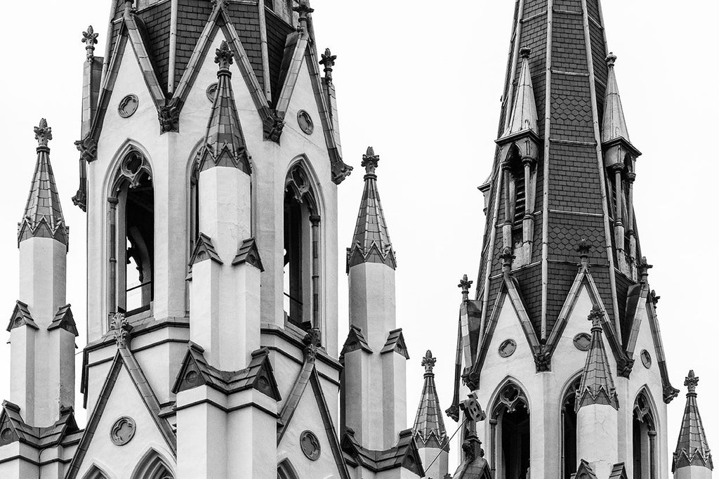 Black and white architectural photograph of the beautiful spires of The Cathedral of St. John the Baptist, in downtown Savannah. The cathedral in its current incarnation was completed in 1896, but was partially destroyed by fire in 1898, and subsequently rebuilt in 1899.