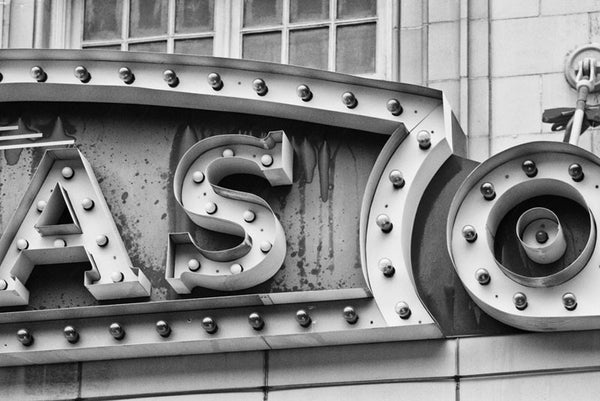 Black and white photograph of a section of the vintage Lucas marquee in Savannah, Georgia, focused on the shapes and textures of the sign's construction.