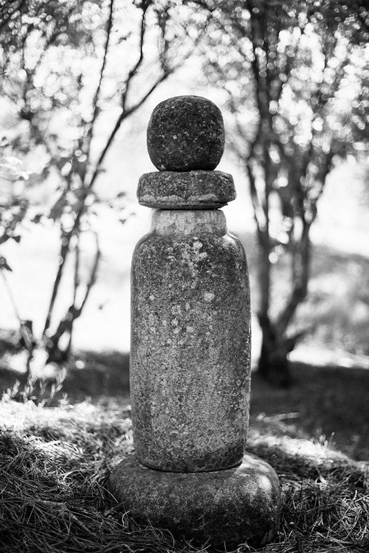 Black and white photograph of a statue in Nashville's Japanese Garden.