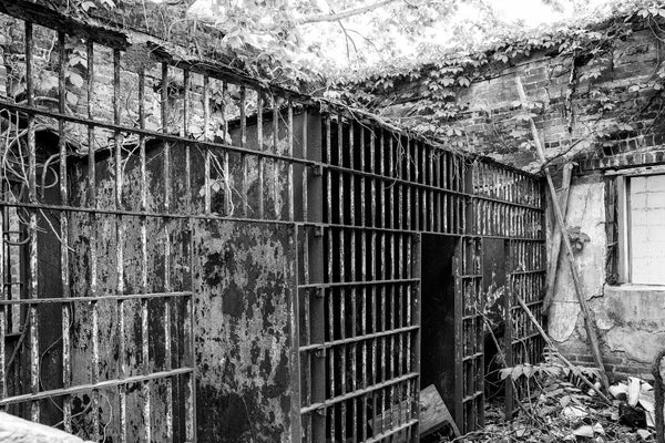 Black and white photograph of the ruined interior of the abandoned old jail in the small Delta town of Itta Bena, Mississippi.