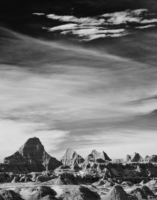 Black and white landscape photograph of the otherworldly Badlands of South Dakota.