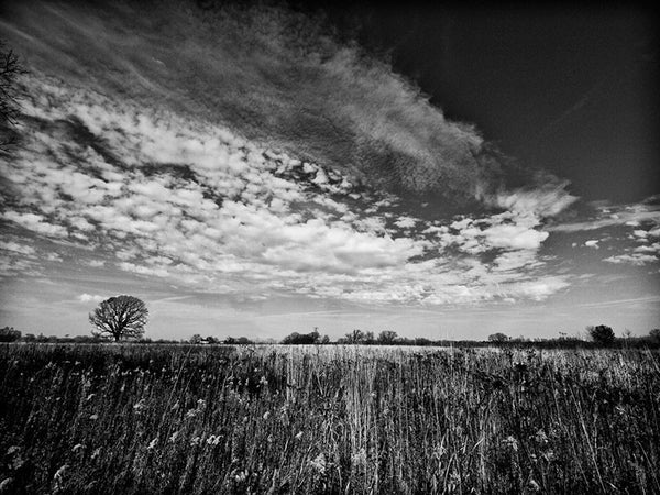 Black and white landscape photograph of big November sky over the northern prairie