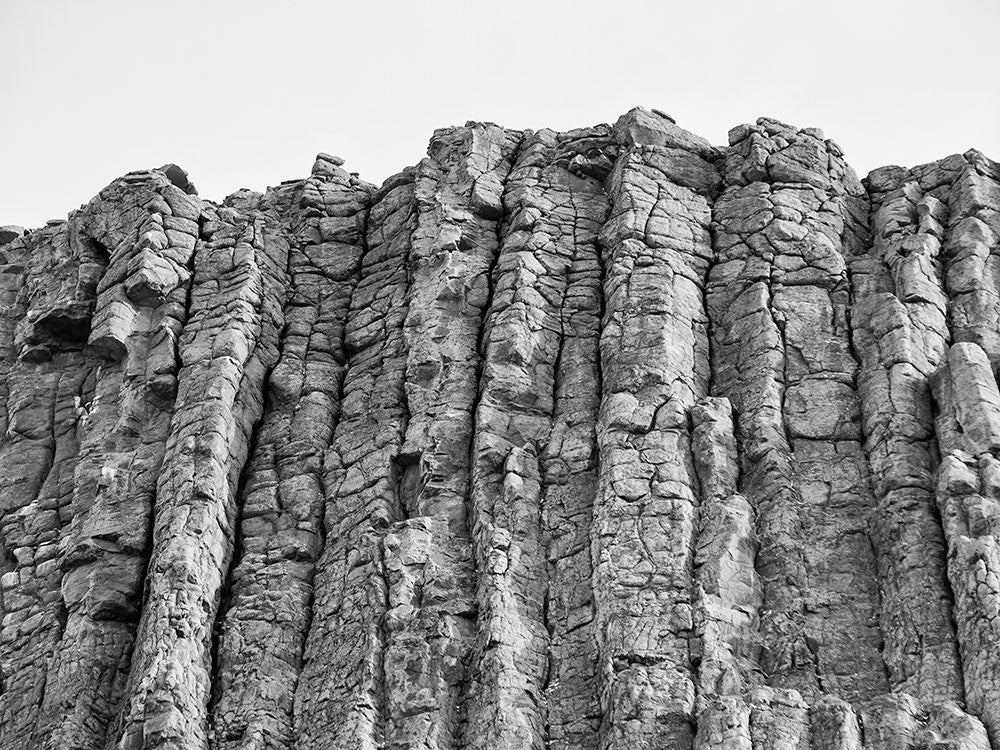 Black and white photograph of the rough, rocky top edge of Devil's Tower, Wyoming.