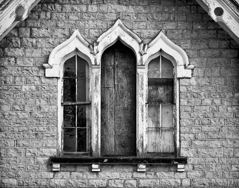Black and white architectural detail photograph of the windows of a carriage house and chapel, built 1840 on the prairie in Dousman, Wisconsin (between Milwaukee and Madison). The church originally founded on the second floor of this small carriage house is still a thriving congregation in a newer building just a short distance away.