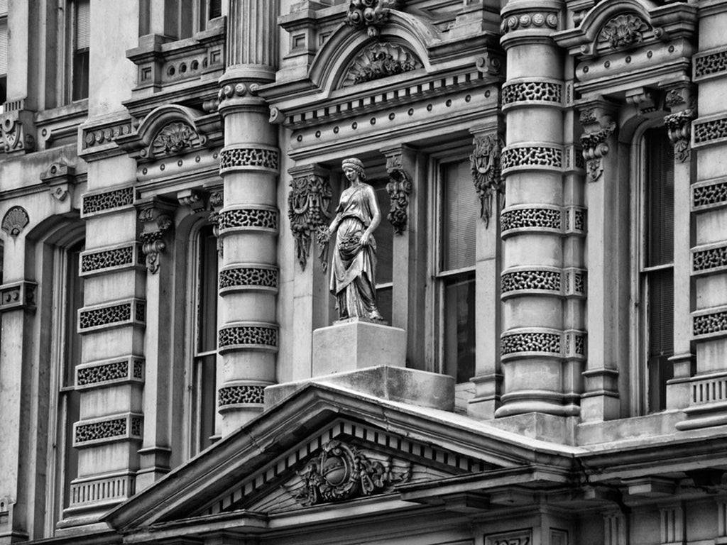 Black and white photograph of the ornate front facade of the Mitchell Building, in downtown Milwaukee. A large print of this photograph can be seen in the Jackson Meeting Room at the Marriott Downtown Milwaukee.