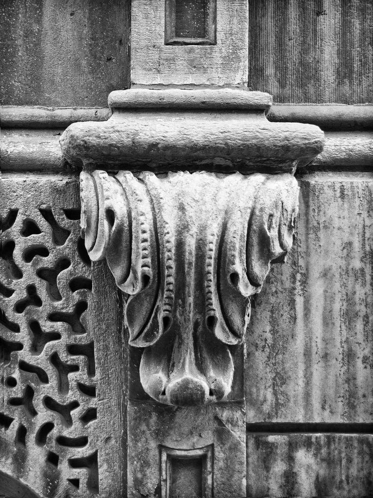 Black and white photograph of a carved stone architectural element on the old Bank of Milwaukee Building (also called the Insurance Exchange Building and the Grand Avenue Club) in downtown Milwaukee