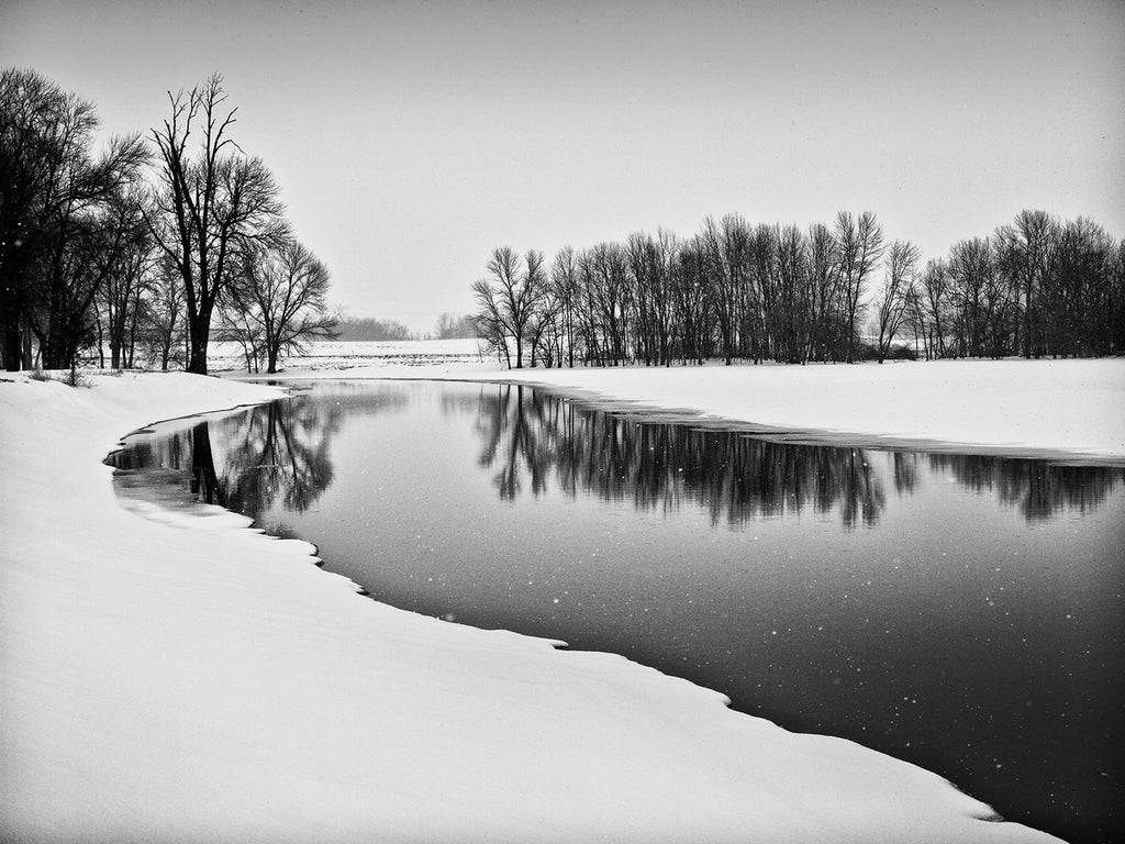 "Black and white landscape photograph made on the location of a former Native American village of the Ho-Chunk (Winnebago) tribe in southern Wisconsin. They lived in this beautiful place, near the river, from the 1700s until 1832, when the village was burned in an intra-tribal attack, associated with the Black Hawk war. The name ""Burnt Village"" was ascribed to the location by the U.S. Army, which camped here afterwards in pursuit of the warrior Black Hawk."