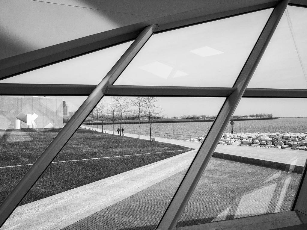 Black and white photograph of the view of Lake Michigan from the windows of Milwaukee Art Museum's stunning Calatrava building.