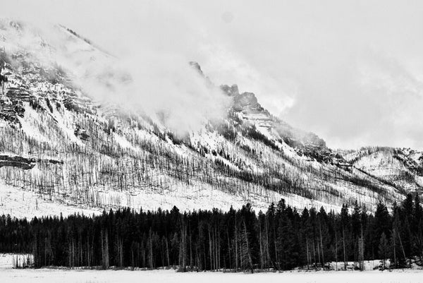 Black and white landscape photograph of Wyoming's Beartooth Mountains in winter.