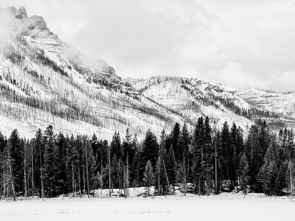Black and white landscape photograph of Wyoming's Beartooth Mountains in snow.