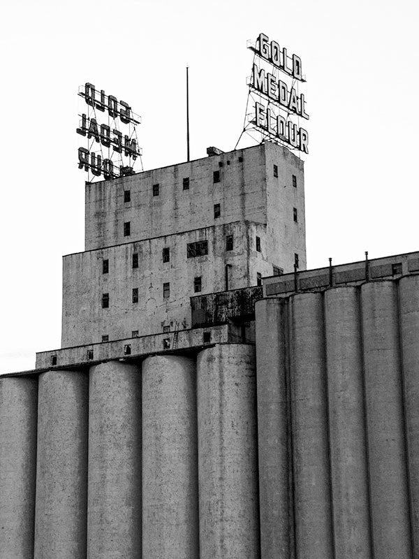 Black and white photograph of the Gold Medal grain silos in downtown Minneapolis.