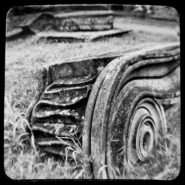 Black and white through-the-viewfinder photograph of an antique Ionic column fragment laying in the grass in Nashville. Through-the-viewfinder (TTV) photography is an alternative style of photography where a camera is focused though the view finder of another camera -- usually a vintage or antique model. This technique gives a uniquely distorted quality.