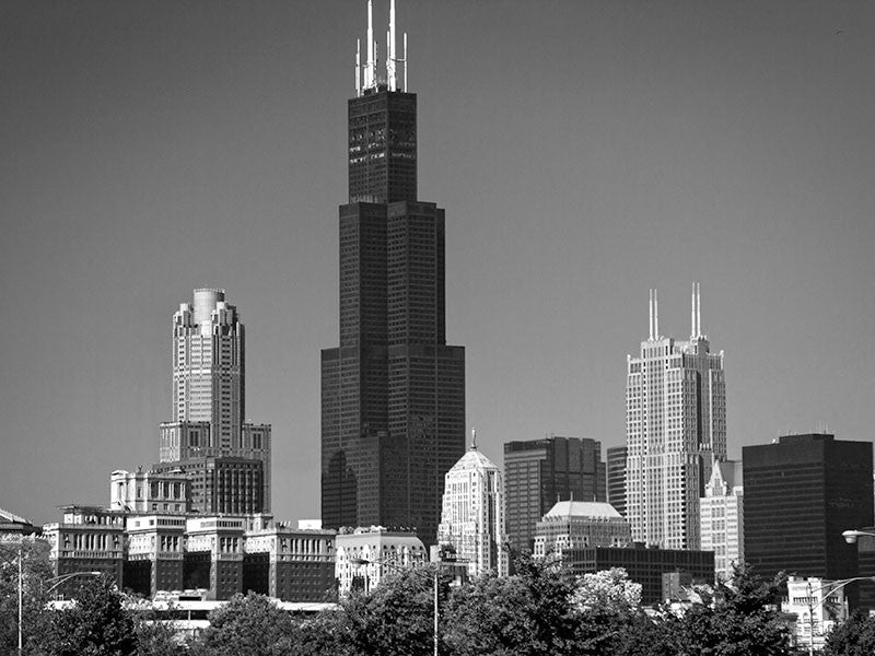 Black and white photograph of the stunning world-class Chicago skyline, focused on the tall black Willis Tower (formerly known as the Sears Tower), which was the tallest building in the world from 1973 - 1998.