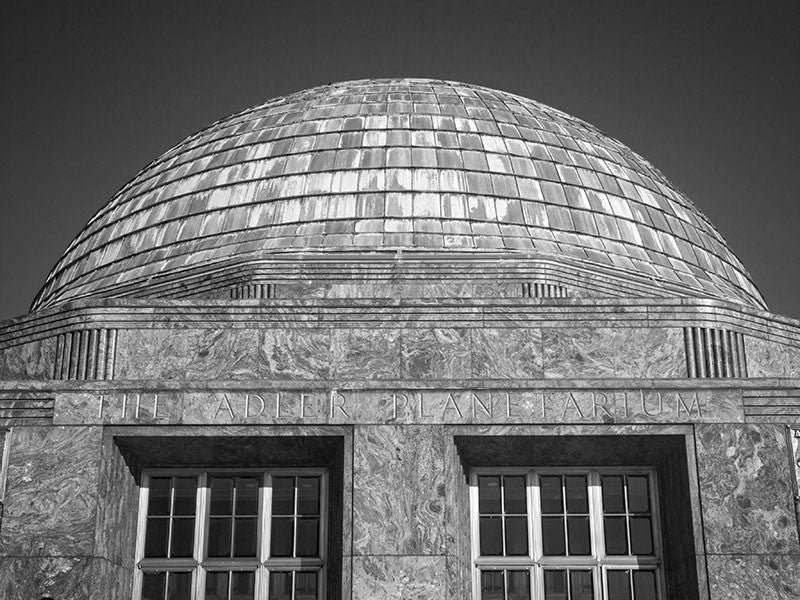 Black and white exterior photograph of Adler Planetarium in Chicago.