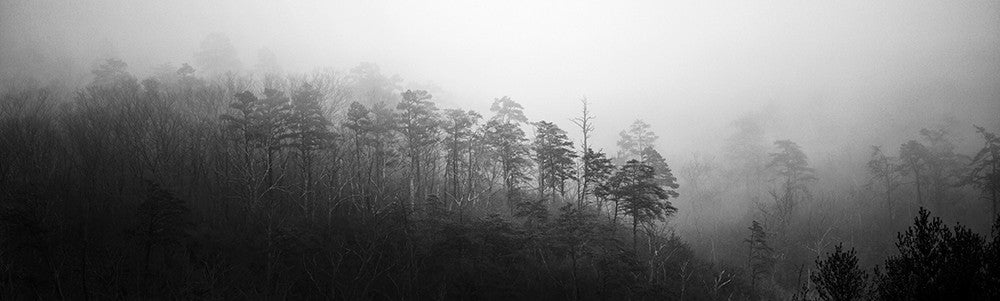 Black and white landscape photograph of foggy mountain ridges in the Smoky Mountains. This is a wide view panorama currently available only in one size: 20 inches wide x 6 inches tall.