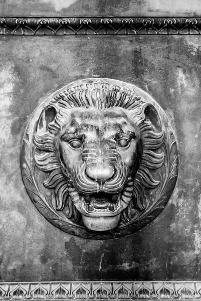 Black and white photograph of a lion head figure on one of the the huge bronze doors on the entrance to Nashville's replica of the Parthenon in Athens. Each of the four double-doors is 24 feet tall, one foot thick, and weighs seven and a half tons.
