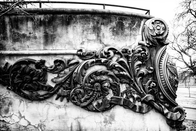 "Black and white photograph of a concrete ship's bow monument to the USS Tennessee (later renamed the ""Memphis""), an armored cruiser launched in 1904. The monument, located in Nashville's Centennial Park, features the actual bronze scrollwork from her bow, which was removed from the ship in 1909. The Memphis was shipwrecked in 1916. The name ""USS Tennessee"" was reassigned to a battleship."