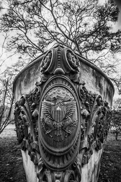 "Black and white photograph of a concrete ship's bow monument to the USS Tennessee (later renamed the ""Memphis""), an armored cruiser launched in 1904. The monument, located in Nashville's Centennial Park, features the actual bronze scrollwork from her bow, which was removed from the ship in 1909. The Memphis was damaged by shipwreck in 1916. The name ""USS Tennessee"" was reassigned to a battleship in 1916."