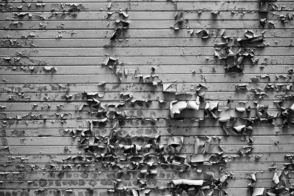 Black and white photograph of peeling paint in the arcade area in downtown Nashville, Tennessee.