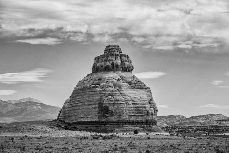 Black and white landscape photograph of an unusual bald rock outcropping in the desert of Utah.