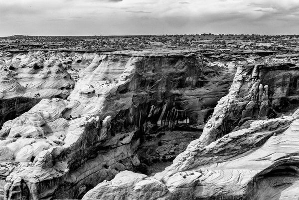 Black and white landscape photograph of Canyon de Chelly in Arizona.
