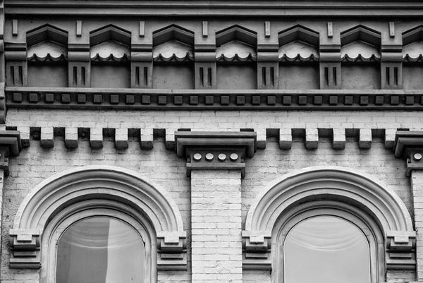 Black and white photograph of a beautifully ornate historic roofline on 2nd Avenue in downtown Nashville.