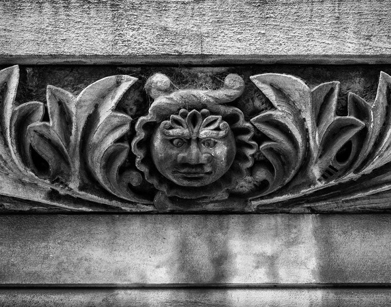 Black and white architectural detail photograph of a strange face carved into the stonework of the historic Utopia Hotel in downtown Nashville. The hotel opened in 1891 to accommodate visitors in town for the Tennessee Centennial Exposition.