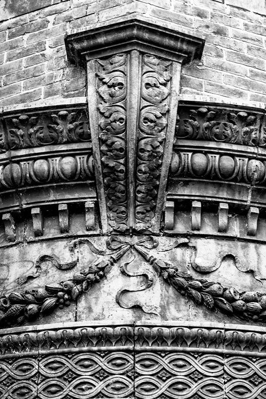 Black and white photograph of a beautiful architectural detail on a historic building in Nashville's Lower Broadway honky tonk district at 2nd Avenue. The structure is currently home to Hard Rock Cafe's gift shop, but opened in the 1890s as the Silver Dollar Saloon, serving riverboat men from the nearby Cumberland River. Also known as the V. E. Schwab Building.