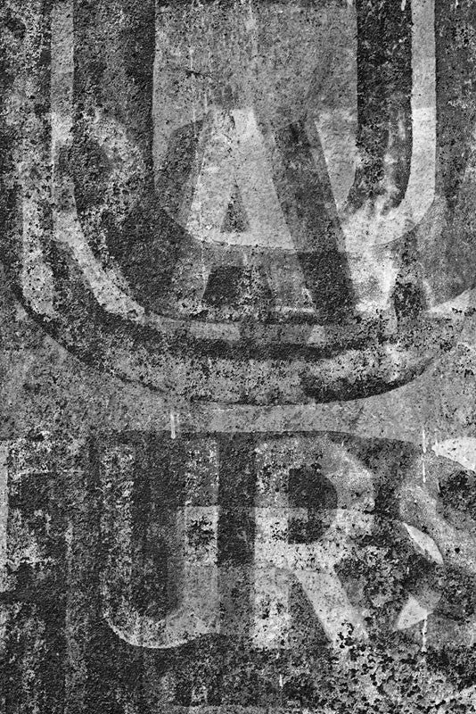 "Black and white fine art photograph of the old painted ""Raw Furs"" signs on the building at 527 Conti Street in the French Quarter of New Orleans, Louisiana."