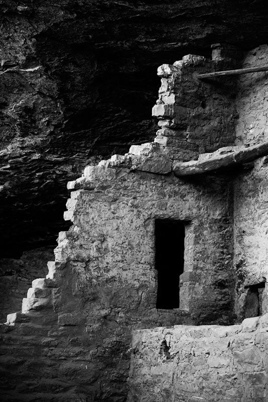 Black and white photograph of one of the centuries old mud-brick walls at Mesa Verde, Colorado.