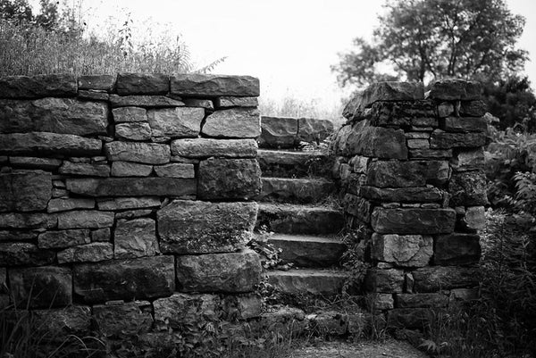 Black and white photograph of the old limestone walls with steps at Fort Negley near Nashville. Fort Negley is a star-shaped structure built of limestone blocks on a hilltop south of the city, and was the largest inland fort built during the American Civil War. The fort was built by the Union army in 1862 as a defensive post after the Confederates lost control of Nashville in successive battles, but with fighting concentrated in other areas, the fort never saw action.