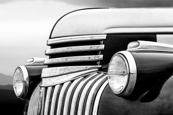 Black and white fine art photograph of an antique 1947 Chevrolet in the mountain landscape.