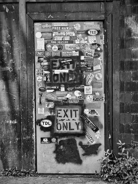 Black and white photograph of the back door to the famous -- even historic --Continental Club on South Congress in Austin, Texas.