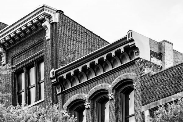 Black and white photograph of the roofline of historic buildings on Second Avenue in Nashville, Tennessee.
