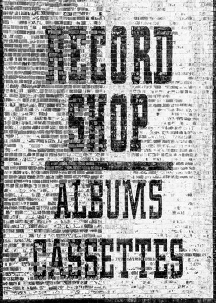 Black and white photograph of a two-story record store sign painted on the side of a brick wall in Nashville's Lower Broadway entertainment district.