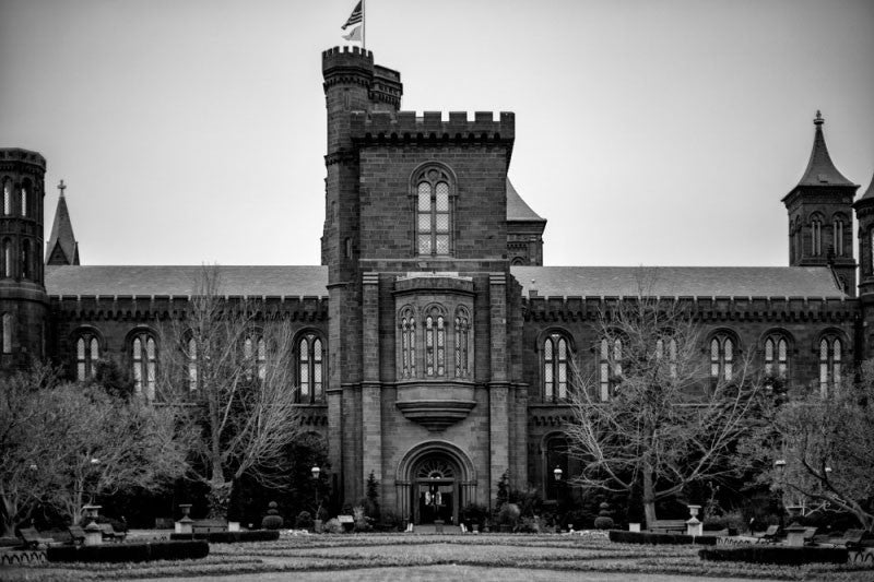 Black and white architectural photograph of ornate stone castle at the Smithsonian Institution in Washington, DC.