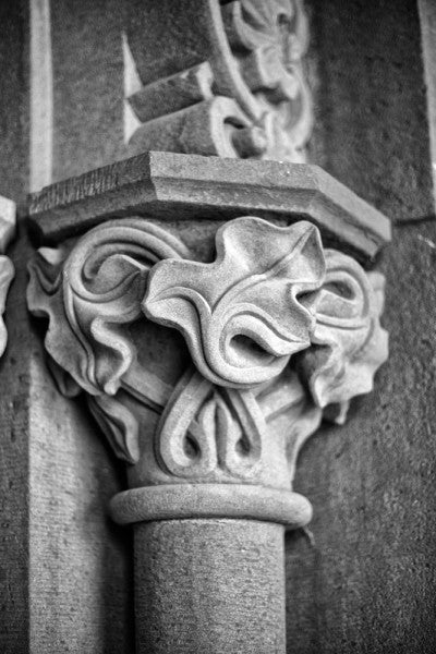 Black and white architectural detail photograph of a column decorated with carved ivy details at the Smithsonian Institution in Washington, DC.
