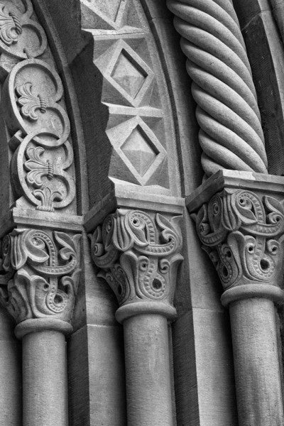 Black and white architectural detail photograph of ornately carved stone columns at the Smithsonian Institution in Washington, DC.