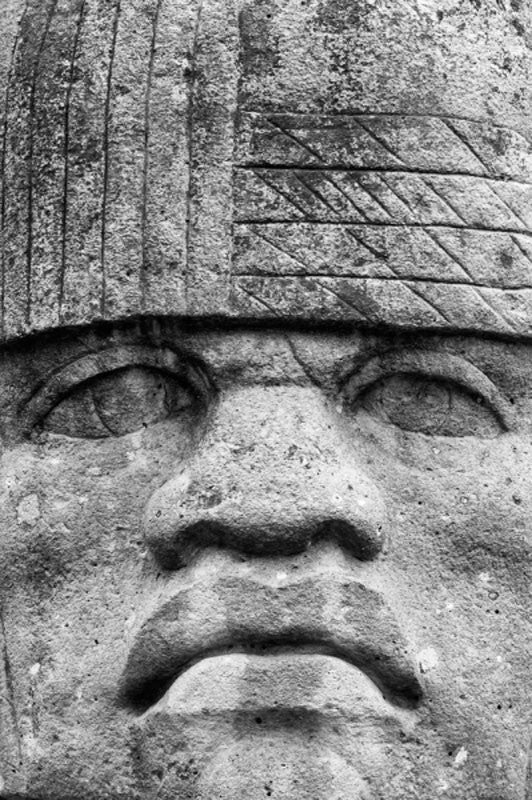 Black and white photograph of the Colossal Head, an Olmec head on display outside the National Museum of Natural History in Washington, D.C.