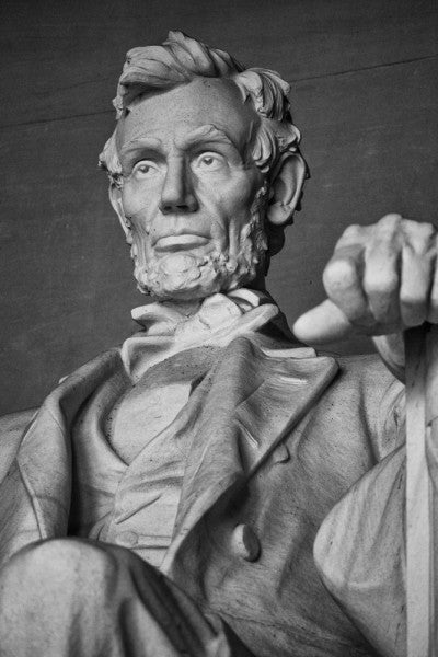 Black and white photograph of the magnificent statue of Abraham Lincoln at the Lincoln Memorial in Washington, D.C.