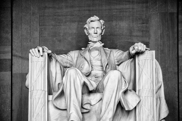 Black and white front view photograph of the magnificent, massive statue of Abraham Lincoln at the Lincoln Memorial in Washington, D.C.