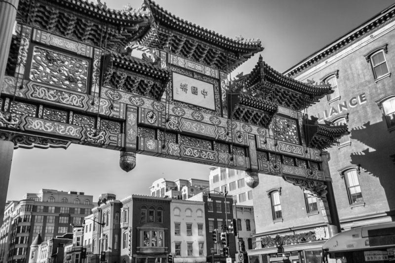 Black and white photograph of the ornate gate at the entrance to the Chinatown neighborhood of Washington, DC.