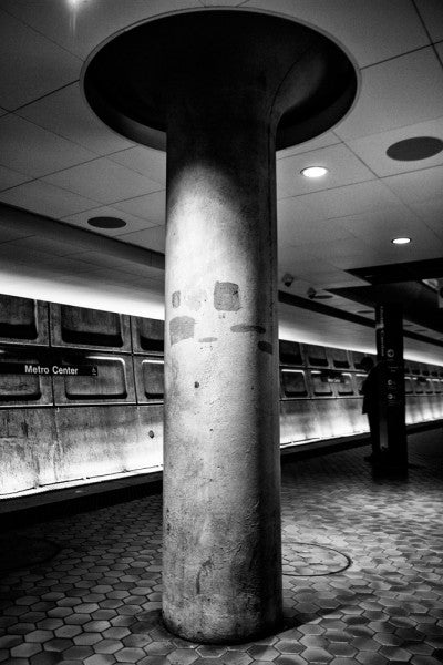 Black and white photograph of the Metro subway underground platform in Washington, DC.