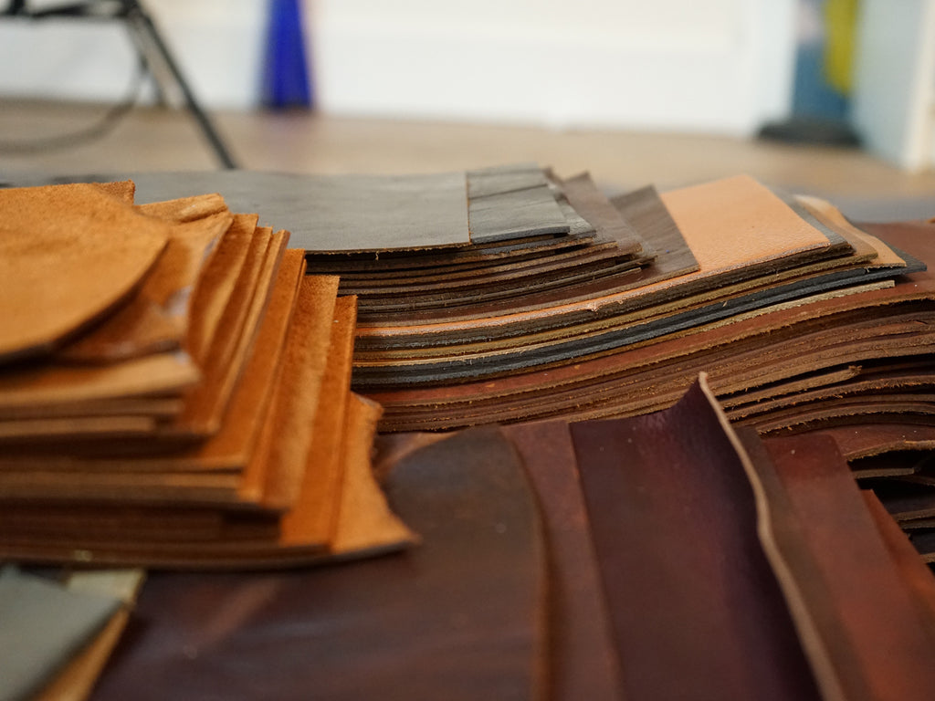 Leather hides being cut