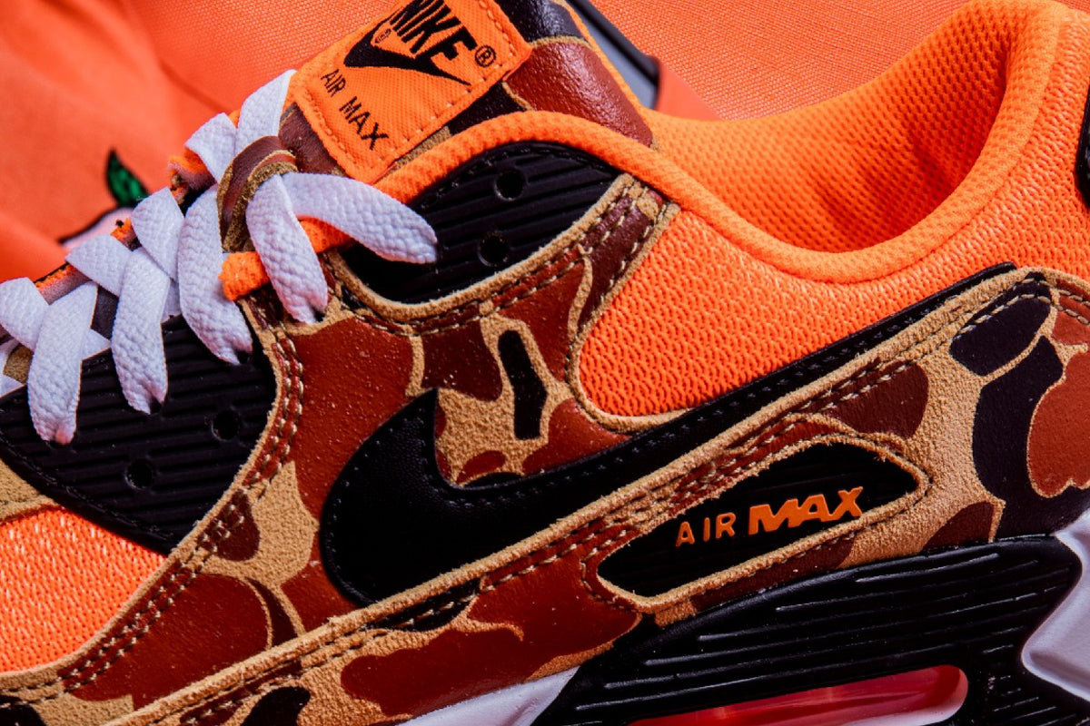 "The Vibrant Duck Camouflage, Nike Air Max 90 ""Orange Camo"" has arrived at JUICE!"